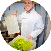 Happy employee with salad tray at Cheff on Call